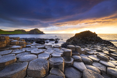CLKMC128195 An epic sunset at the Giant's Causeway with it's iconic basalt columns. County Antrim, Ulster region, Northern Ireland, United Kingdom.