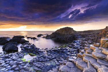 CLKMC128204 An epic sunset at the Giant's Causeway with it's iconic basalt columns. County Antrim, Ulster region, Northern Ireland, United Kingdom.