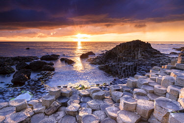 CLKMC128207 An epic sunset at the Giant's Causeway with it's iconic basalt columns. County Antrim, Ulster region, Northern Ireland, United Kingdom.