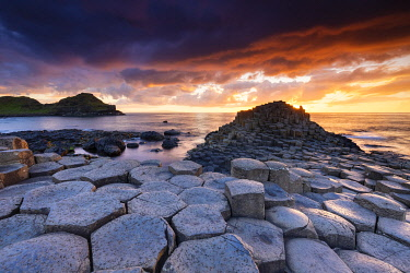 CLKMC128211 An epic sunset at the Giant's Causeway with it's iconic basalt columns. County Antrim, Ulster region, Northern Ireland, United Kingdom.