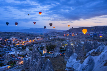 CLKGM127834 Hot air balloons flying in the blue sky of Goreme at dusk. Goreme, Cappadocia, Kaisery district, Anatolia, Turkey.