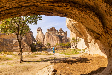CLKGM127845 Trekking into Zelve valley between rock formations. Goreme, Kaisery district, Anatolia, Turkey.