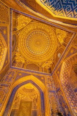 CLKGM128349 Gold gild in the interior mosque dome of Tilla Kari, Tilya Kori, madrasah. Registan square, Samarkand, Uzbekistan, Central Asia.