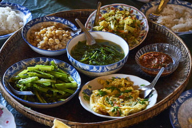 IBLGTH05141115 Various vegetarian small dishes on a tray, Shan village, Pyin U Lwin, Mandalay District, Myanmar, Asia