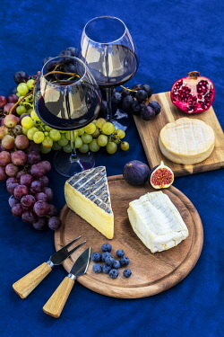 FRA11839 France.  Different types of soft and semi soft cheese from various regions of France including  Reblochon, Brie, Tomme de Savoie and  Carre de l Est accompanied with fresh grapes, blueberries, figs, p...