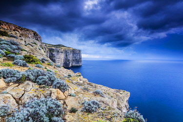 MLT0707 Maltese Islands. Gozo. The dramatic cliffs of Dwejra in stormy weather.