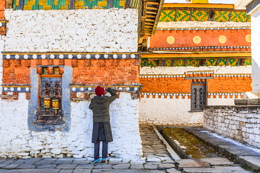 A man in Jambey Lhakhang, Jakar, Bumthang District, Bhutan