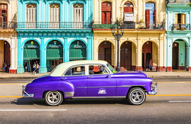 CUB2458AWRF Classic car driving in Centro Habana Province, Havana, Cuba