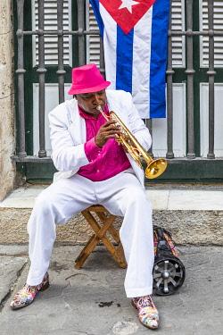 CUB2316AW A trumpet player in Plaza de Armas, La Habana Vieja (Old Town), Havana, Cuba