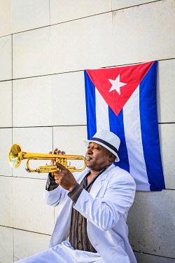 CUB2376AW A trumpet player in Plaza de Armas, La Habana Vieja (Old Town), Havana, Cuba