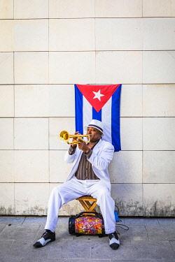 CUB2377AW A trumpet player in Plaza de Armas, La Habana Vieja (Old Town), Havana, Cuba