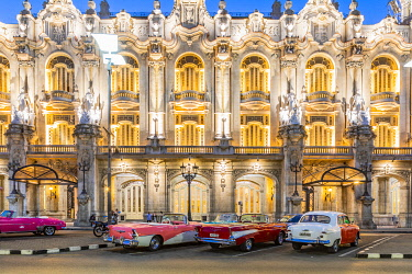 CUB2388AW Classic cars parked in front of the Gran Teatro de La Habana (otherwise known as Grand Theatre of Havana) at night, Centro Habana Province, Havana, Cuba