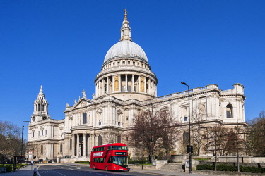 ENG16912AW United Kingdom, England, London, City of London, Cannon Street. Red London double-decker bus passing in front of St. Paul's cathedral