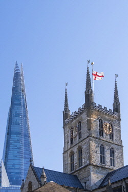 ENG16914AW United Kingdom, England, London, Southwark. The tower of Southwark cathedral with an English flag flying and the Shard building behind