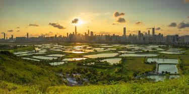 CH12447AWRF Skyline of Shenzhen from Sheung Shui at sunset, New Territories, Hong Kong