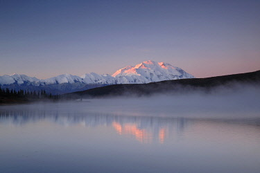 NIS00074924 Morning light touches Mount Denali and the Alaska Range while mist rises from Wonder Lake, Denali National Park and Preserve, Alaska, United States
