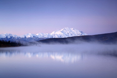 NIS00074927 Scenic view of Mount Denali and the Alaska Range while morning mist rises from Wonder Lake, Denali National Park and Preserve, Alaska, United States