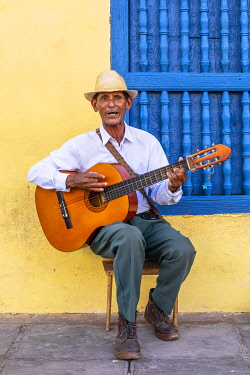 CUB2493AW A musician playing the guitar in Plaza Mayor in Trinidad, Sancti Spiritus, Cuba