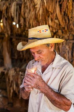 CUB2540AW A tobacco farmer smoking a Cuban cigar in Vinales, Pinar del Rio Province, Cuba
