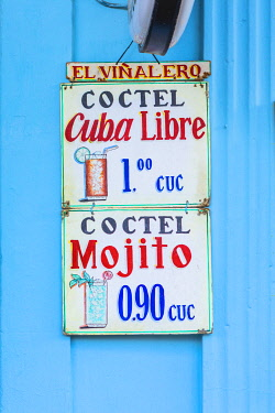 CUB2553AW A sign hanging outside a bar in Vinales Town, Pinar del Rio Province, Cuba