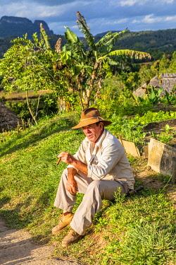 CUB2559AW A farmer smoking a cigar in Vinales Valley, Pinar del Rio Province, Cuba