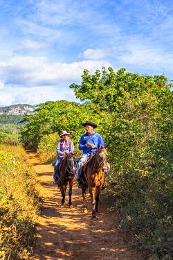 CUB2566AW People riding horses in Vinales Valley, Pinar del Rio Province, Cuba