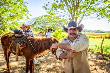CUB2569AW Cowboys in Vinales Valley, Pinar del Rio Province, Cuba
