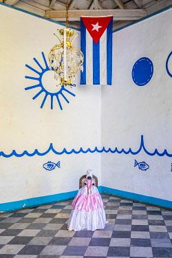 CUB2492AW A doll in the entrance of a building in Trinidad, Sancti Spiritus, Cuba