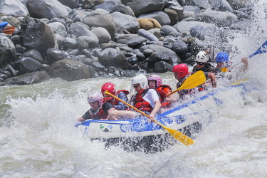 CR33291AW A group of people white water rafting, Costa Rica, Central America