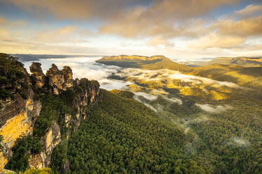 AUS4365AW Cloud inversion over Jamison Valley surrounding Mount Solitary and The Three Sisters, Blue Mountains National Park, New South Wales, Australia