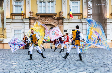 ROM1828 Romania. Timisoara. Flag throwers from Italy during a food festival in Piata Unirii, one of the city's main squares.