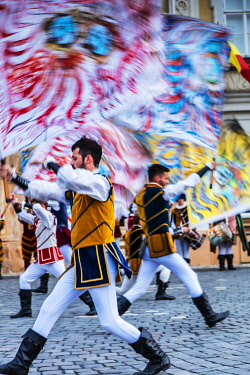 ROM1830 Romania. Timisoara. Flag throwers from Italy during a food festival in Piata Unirii, one of the city's main squares.