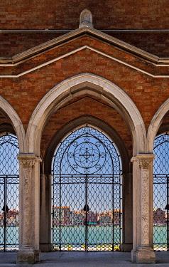 ITA15514 Architectural detail of the mortuary wall and gates of the Cemetery of San Michele. looking towards the region of Canneregio from Isola, Murano, Venice, Veneto, Italy.