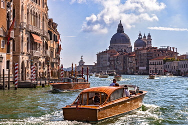 ITA15522 Boat traffic on the Grand Canal, with the Basilica di Santa Maria della Salute Church in the background, San Marco, Venice, Veneto, Italy.