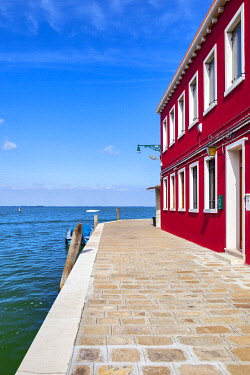 ITA15526 Colourful building at the end of a canal on the island of Murano, Venice, Veneto, Italy