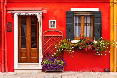 ITA15529 Architectural door and window detail of a residential house on the Island of Burano, Venice, Veneto, Italy