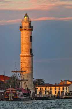 ITA15530 The Faro Murano lighthouse at sunset on the Island of Murano, Venice, Veneto, Italy