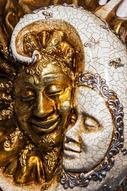 ITA15533 An ornate Venetian carnival mask shop display, located in the Cannaregio District of Venice, Veneto, Italy.