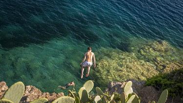 ITA15545AW Europe, Italy, Tuscany, Elba Island - Cliff juming in the bay of Barbarossa.