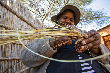 BOT5552AW A traditional basket weaver in Maun, Botswana