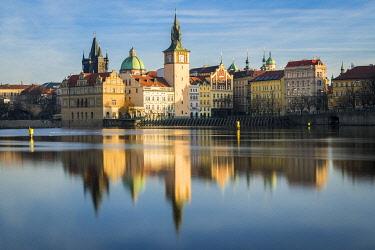 CZE2324AWRF Reflection of Bedrich Smetana Museum and Old Town Waterworks at Smetanovo nabrezi, Prague, Bohemia, Czech Republic