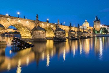 CZE2331AWRF Illuminated Charles bridge with reflections at night, Prague, Bohemia, Czech Republic