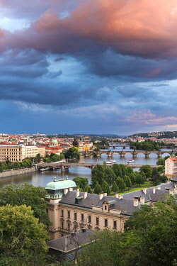 CZE2335AWRF Bridges over Vltava river and Straka Academy against sky seen from Letna park at sunset, Prague, Bohemia, Czech Republic