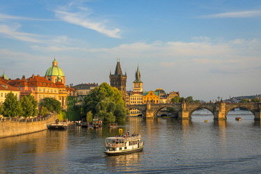 CZE2348AWRF Boat going towards Charles Bridge and Old Town Bridge Tower, Prague, Bohemia, Czech Republic