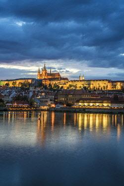 CZE2351AWRF Illuminated Prague Castle and Charles Bridge against cloudy sky at night, Prague, Bohemia, Czech Republic