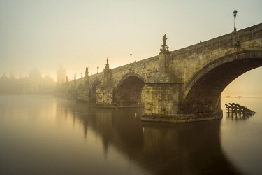 CZE2251AW Charles Bridge with mist at sunrise, Prague, Bohemia, Czech Republic