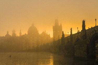 CZE2253AW Charles Bridge with mist at sunrise, Prague, Bohemia, Czech Republic