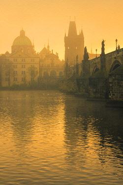 CZE2254AW Charles Bridge with mist at sunrise, Prague, Bohemia, Czech Republic