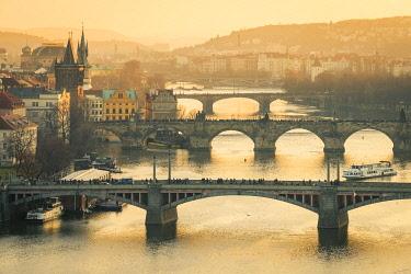 CZE2258AW Bridges over Vltava river in city at sunset, Prague, Bohemia, Czech Republic