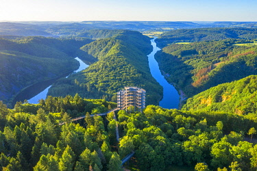 GER12167AW Aerial view on the sunrise above the Baumwipfelpfad, treetop walk at the Grand Saar horseshoe bend, Orscholz, Saarland, Germany